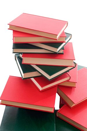 studding: Many books red and green  stacked on a white background