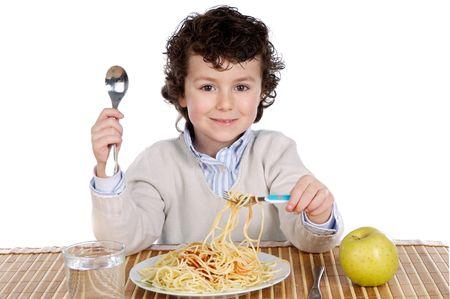 Precious child eating spaghetti on a white background Stock Photo - 3692259