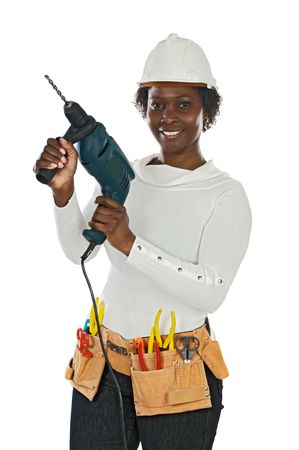 woman hard working: African american woman with helmet and tools a over white background