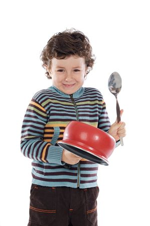 noise isolation: Naughty boy making noise with a saucepan on a white background Stock Photo