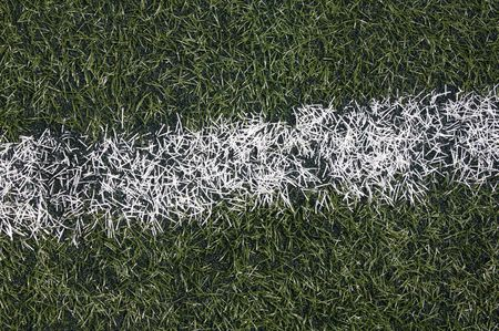 Field of soccer. The artificial grass with one white line photo