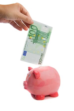 Saving a note of one hundred euros in a piggy-bank a over white background photo