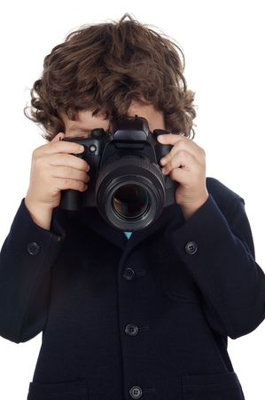 taking photograph: Young boy taking photo with camera over white background