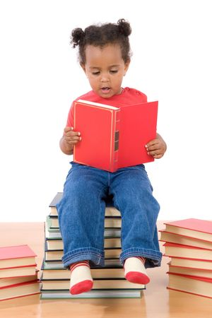 Adorable african  reading sitting on a pile of books on a over white background