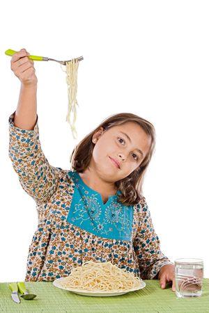 Precious girl eating spaghetti on a white background Stock Photo - 3749277