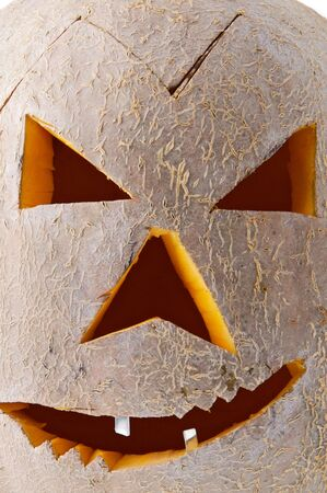 Macro of scary carved Halloween pumpkin face. Stock Photo - 3749278