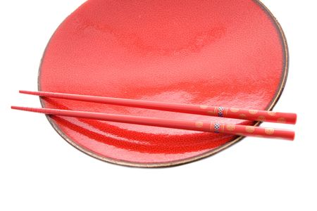 Red dish and chopsticks with oriental style on a white background Stock Photo - 3768623