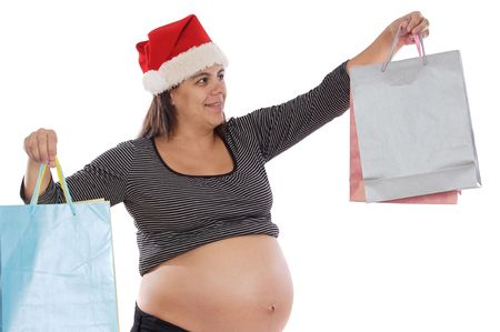 Pretty pregnant woman shopping with Santa Claus hat photo