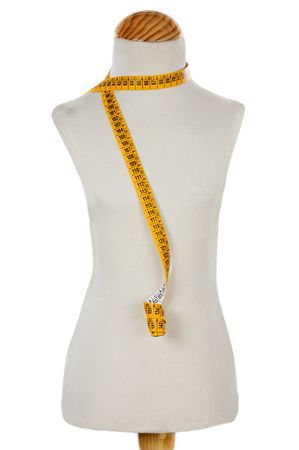 Mannequin with a tape measure on a over white background