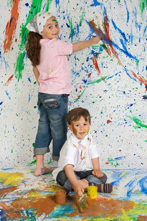 Children playing with painting with the background painted photo
