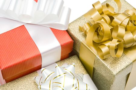 Many beautiful gifts on a over white background photo