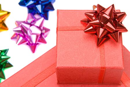 Many gifts and bows of different colors on a over white background photo