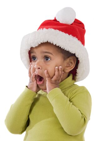 surprised child: Surprised baby girl with red hat of Christmas on a over white background
