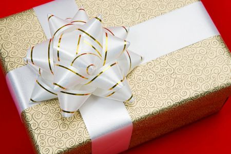 One beautiful gift on a over red background Stock Photo - 3817879
