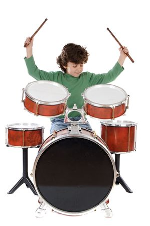 Beautiful boy playing the drums on a white background
