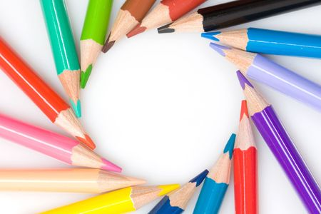 Many pencils forming a circle on a over white background photo