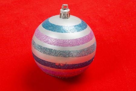 silvered: Silvered ball of christmas on a over red background Stock Photo