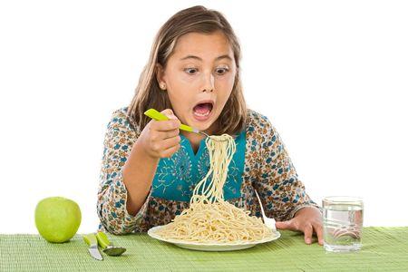 Precious girl eating spaghetti on a white background Stock Photo - 3850775