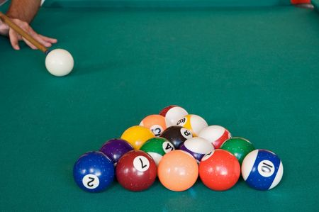 Playing billiards with balls on a green felt table photo