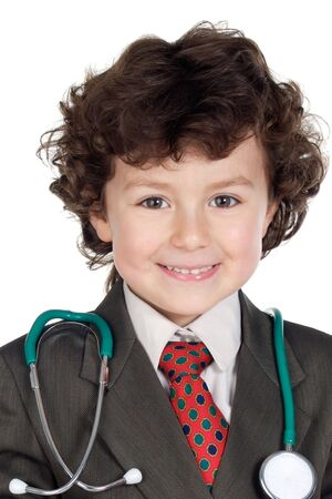 Beautiful boy playing to be doctor on a over white background photo