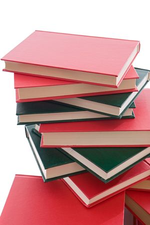 studding: Tower of red and green books on a white background Stock Photo