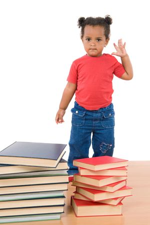 Adorable african baby with many books on a white background photo