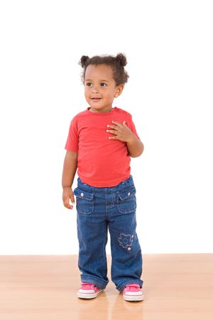 Adorable african baby standing over wooden floor Stock Photo