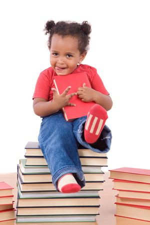 Adorable african baby sitting on a pile of books on a over white background photo
