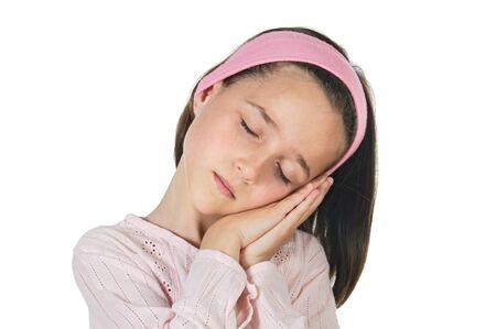 Sleeping lovely girl a over white background Stock Photo - 3940190