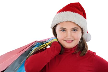Beautiful girl with hat of christmas and bags on a over white background Stock Photo - 3958290