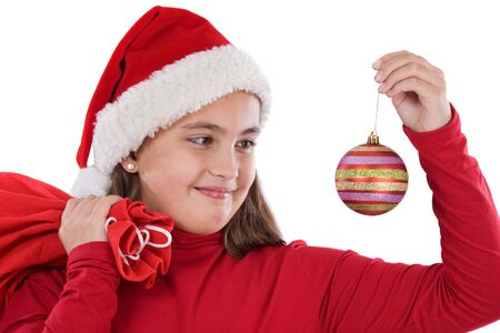 Beautiful girl with red ball of christmas on a over white background photo