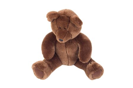 Photo of brown teddy bear isolated over white photo