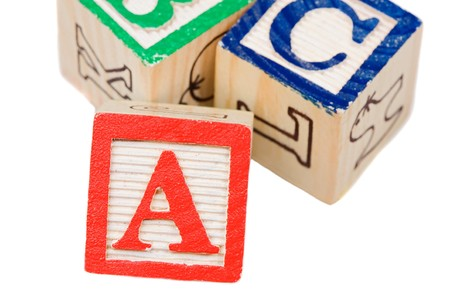 Alphabet learning blocks isolated over white photo