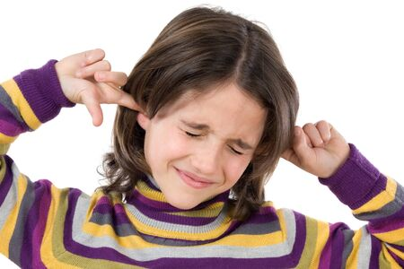 noise isolation: Pretty girl covering her ears on a over white background
