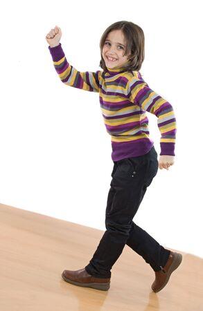 Joyful little girl walking on a over white background Stock Photo - 3988664