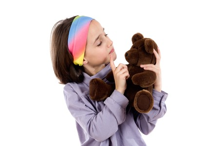 Pretty girl scolding teddy bear on a over white background photo