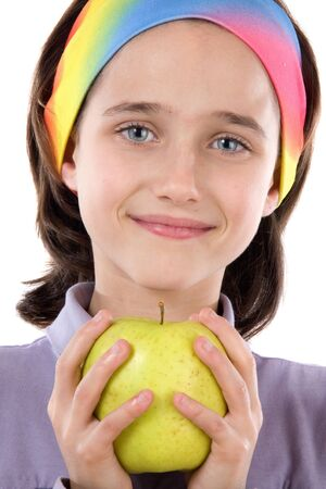Adorable girl with a apple on a white background  photo