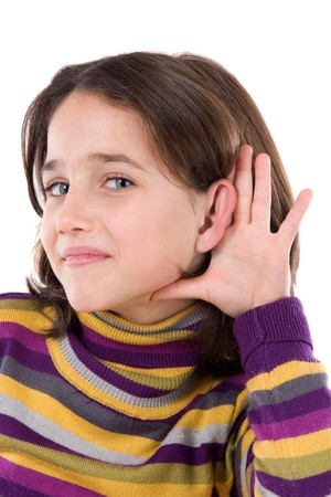 gesticulate: Adorable girl hearing on a over white background