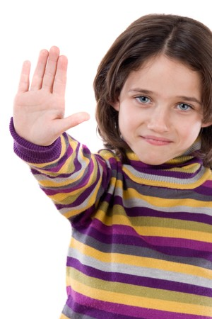 Beautiful girl saying stop with her hand on a white background photo