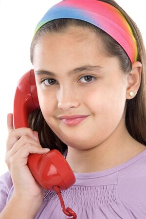 Beautiful girl with red telephone on a over white background photo
