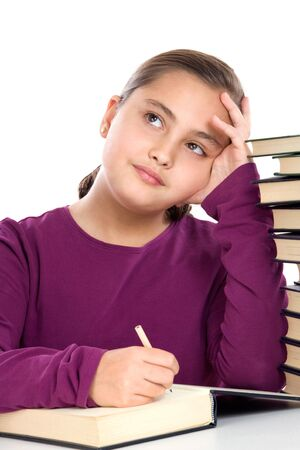 Adorable girl with many books thinking on a over white background photo