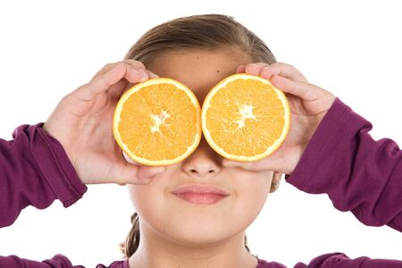Cute girl playing with oranges a over white background photo