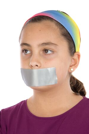 silenced: Beautiful girl with adhesive on her mouth isolated over white