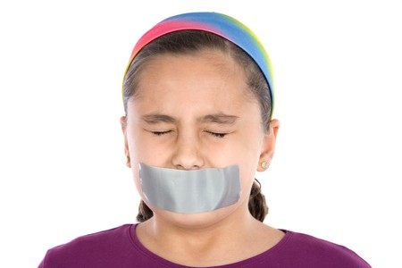 Beautiful girl with adhesive on her mouth and closed eyes isolated over white Stock Photo - 4003163