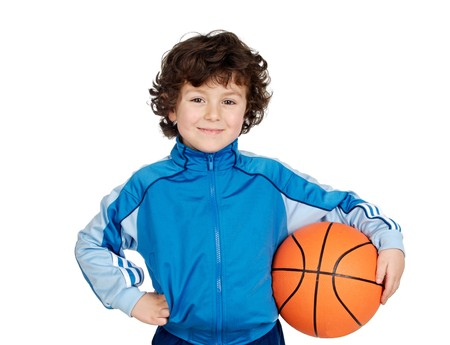 balls kids: Adorable child playing the basketball a over white background