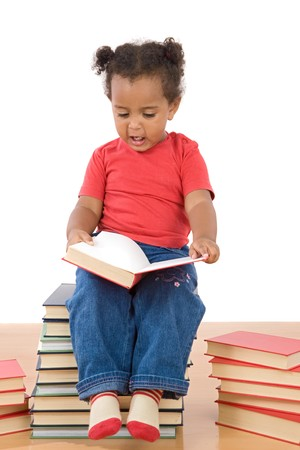 Adorable african baby reading sitting on a pile of books on a over white background photo