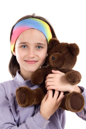 Pretty girl with teddy bear on a over white background photo