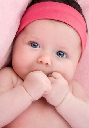 Photo of adorable baby newborn with blue eyes