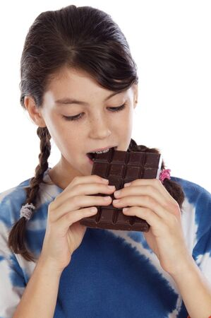 Adorable girl eating chocolate on a over white background Stock Photo - 4109535