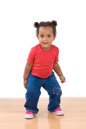 Adorable african baby dancing over wooden floor Stock Photo - 4119271